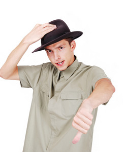 Sexy man with a hat on head and thumb down