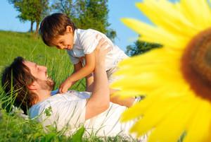 Happy childhool on green meadow