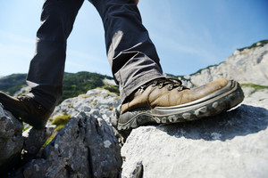Leg foot standing on rock in mountains