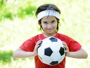 Young boy with soccer outdoor