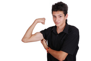 Teenager showing biceps