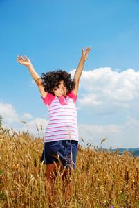 A little pretty girl on wheat field