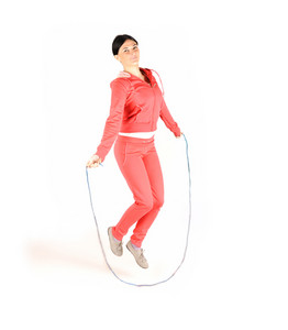 Girl jumping over rope