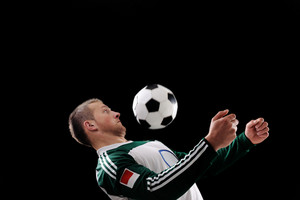 Young football player with ball