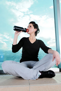 Fitness sporty girl  excercising and drinking a water