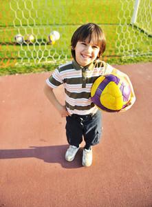 Young kid enjoying soccer