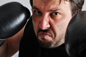 Young man with black boxing gloves