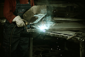 Worker cutting iron with professional tool