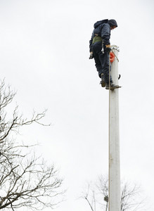 Electrician working at height