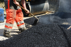 Hard work on asphalt construction