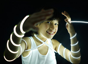 Portrait of kid with led strip light