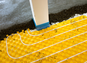 Installing underfloor heating and colling pipes