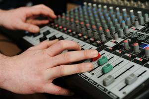 Closeup audio mixer with buttons