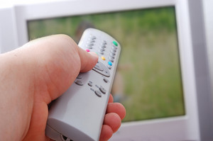 Remote control in hand headed into television
