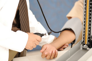 Doctor measures the pressure of the patient in the clinic