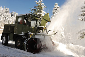 Special winter vehicle for removing snow from road in action