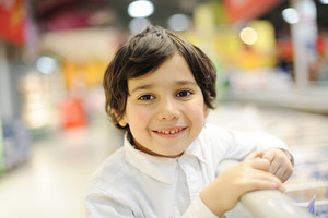 Handsome child in shopping