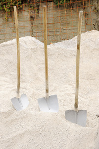 Three shovels prepared for work on sand (pedestrian)