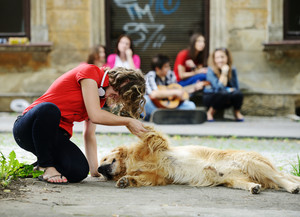 Young real people on the street with dog