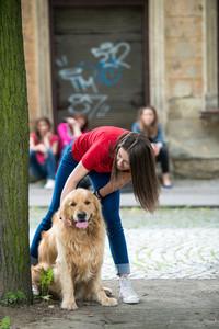 Beautiful teenage girl cuddling a dog