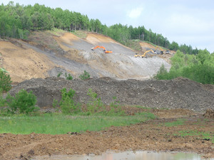 Excavation of a pit. production of gray crushed stone for road powder.