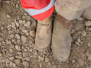 The specialist footwear for workers. comparison of the different sizes of footwear.