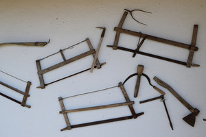 The old peasant tools. tools on the wall.