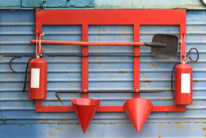 Fire shield on the wall. set primary fire extinguishing equipment.