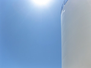 White tank in the sun. equipment for primary oil refining.