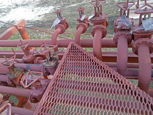 Valves on the pipeline for pumping oil. pipes at the refinery.