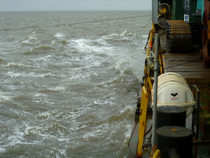 View ship deck edge. sea waves and the feed vessel.