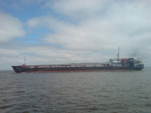 The cargo ship with the crane. pipelaying barge.