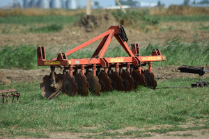 The disk harrow. agricultural machinery for processing of the soil in the field.