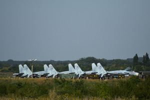 Fighter aircrafts. military airfield and parking lots of planes.