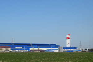 Big plant for processing scrap metal. huge factory old metal refiner. blue roof of the factory building. exhaust pipes