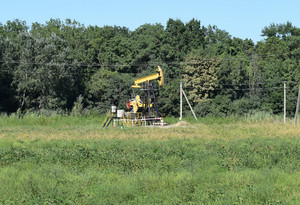 The pumping unit as the oil pump installed on a well. equipment of oil fields.