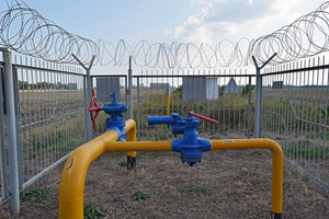 The latch on the underground gas pipeline protected with a fence.