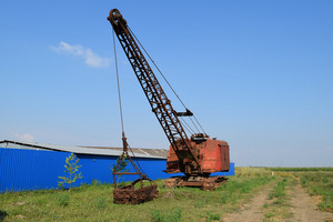 Old dragline. old equipment for digging the soil in canals and quarries.