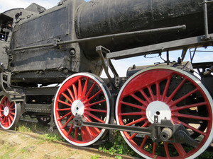 Steam locomotive rolling close up