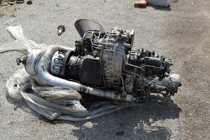 The helicopter engine which is pulled out outside. spare parts and details of a design of helicopters.