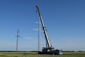 The elevator crane on a truck platform.