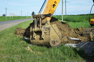 Bucket of the excavator on installation of the basis of electrocolumns.