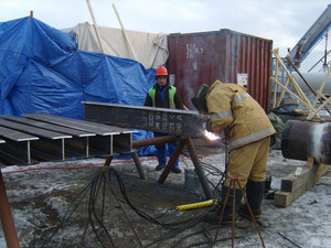 The worker is occupied with welding works. two-tauri