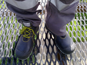 Overalls of the oil industry worker. boots and trousers.