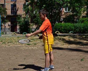 Child playing badminton