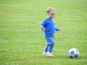 Child and a soccer ball