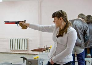 Girl shoots a gun.