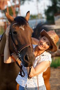 Woman embrace horse