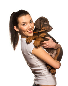 Brunette girl with her puppy isolated on white background