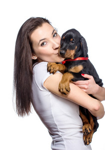 Happy doberman puppy owner isolated on white background